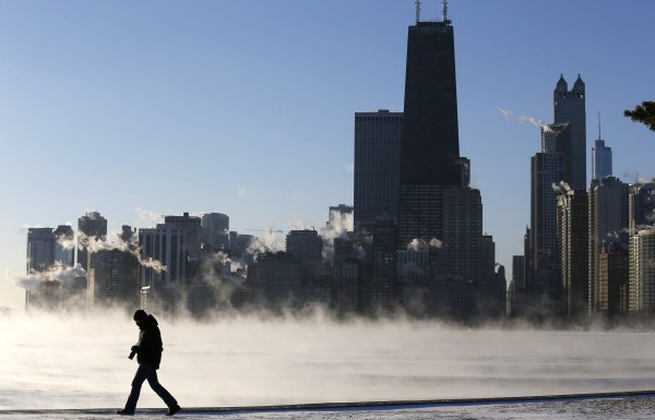 A man is silhouetted against the arctic sea smoke rising off Lake Michigan in Chicago on Monday. A blast of Arctic air gripped the Midwest, bringing the coldest temperatures in two decades.
