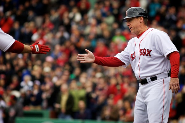 Maine native and current Standish resident Brian Butterfield congratulates David Ross as he rounds the bases after slugging the ball over the Green Monster at Fenway Park on April 13, 2013.