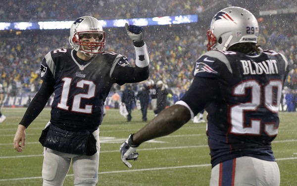 New England Patriots running back LeGarrette Blount (29) is congratulated by quarterback Tom Brady (12) after he scored a touchdown during the second quarter of their 34-20 win over the Buffalo Bills at Gillette Stadium on Dec. 29, 2013.