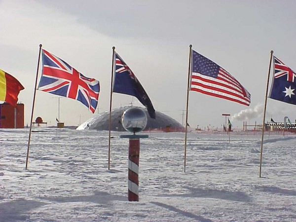 The ceremonial marker at the South Pole is surrounded by flags of the original signatory nations of the Antarctic Treaty. Teenage polar explored Parker Liantaud recently trekked to the South Pole to help further understanding of climate change.