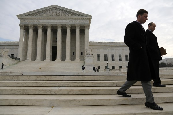 People walk outside the U.S. Supreme Court in Washington in December.