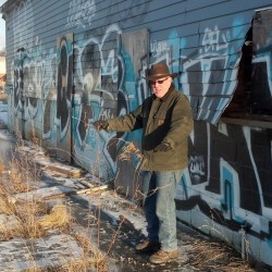 Greg Shinberg, a Portland-based consultant for The Federated Cos., surveys an industrial lot along Somerset Street that may become part of the developer's proposed Midtown housing and retail complex.