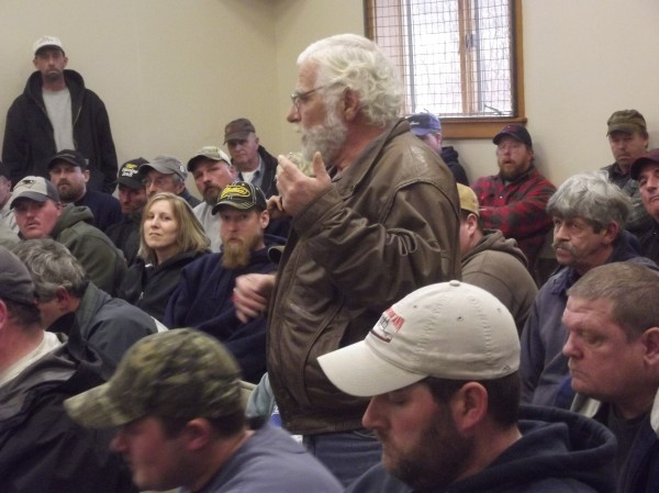 Leo Murray of Lubec addresses meeting of fishermen in Whiting on Friday. State officials are considering emergency measures to reduce the scallop harvest.