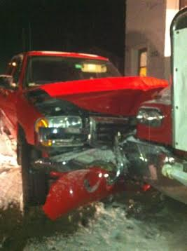 The front end of a GMC pickup after it struck a parked commercial wrecker on Friday.