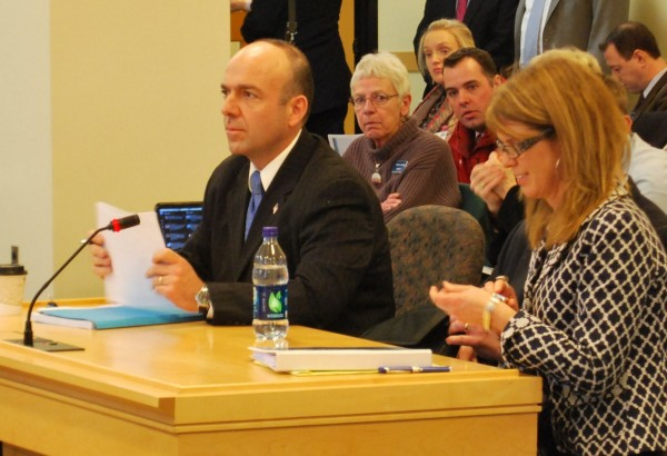 Rhode Island welfare consultant Gary Alexander (left) and Maine Department of Health and Human Services Commissioner Mary Mayhew prepare Tuesday to answer questions from the Health and Human Services Committee at the Cross Office Building in Augusta.