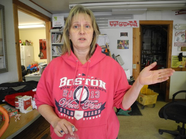 Susan Totman stands in her small family garage business on Jan. 7. She expressed her concerns about the natural gas compressor station she lives near in Searsmont.