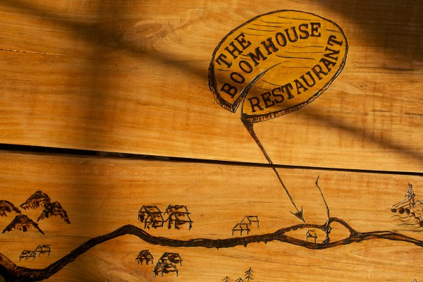 A table with wood-burned engravings are a part of the Boomhouse Restaurant's rustic decor in Old Town.