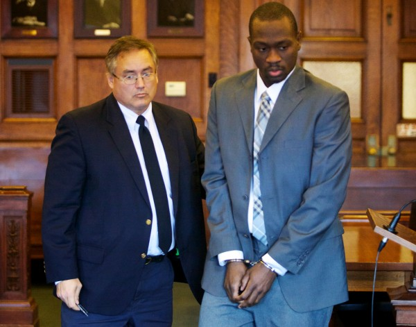 Eric Gwaro is led away in handcuffs in July 2013 after being found guilty of elevated aggravated assault for the beating of Sherri York. He was acquitted on attempted murder charges. Gwaro on Monday was sentenced to 8 years in prison for beating York.