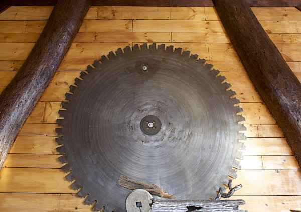 A giant saw mill blade hangs from a wall at the new Boomhouse Restaurant on the river front in Old Town.
