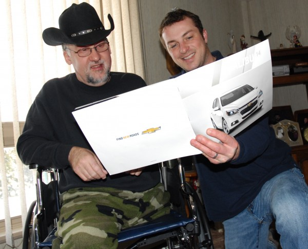 Kevin Pelletier (left) checks out the options on his Chevy Malibu dream car with Valley Motors sales representative Ken Marquis. Marquis and Valley Motors are spearheading a fundraising campaign to buy a Malibu for Pelletier after an accident in September that claimed his leg.