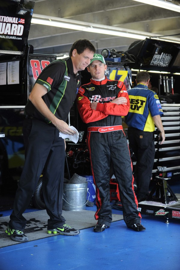 NASCAR Sprint Cup Series driver Regan Smith (88) talks to crew chief Steve Letarte during practice for the Bank of America 500 at Charlotte Motor Speedway on Oct. 12, 2012.
