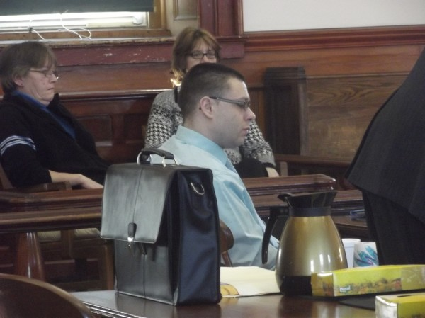 Seth Larkin sits at defense counsel table in Washington County Superior Court on Tuesday.