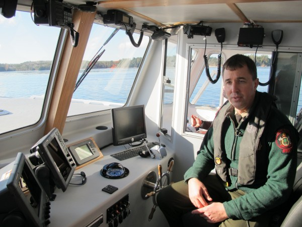 Specialist Colin MacDonald of Marine Patrol sits on the patrol vessel Dirigo II on Wednesday. The new $410,000 boat was ceremonially launched Wednesday at Abel's Boatyard on Mount Desert Island.