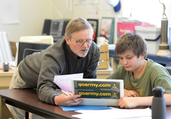 English teacher Jeff Shula helps ninth-grader Cameron Watt during class at Searsport District High School on Thursday.