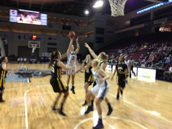 UMaine's Liz Wood puts up a shot over Maryland Baltimore County's Bridget O'Donnell while UMaine's Mikaela Gustafsson battles for position in the first half of a game Wednesday night at the Cross Insurance Center in Bangor.