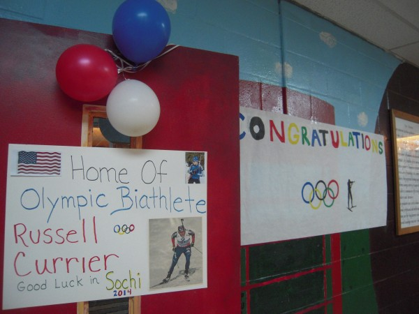 Posters honoring Caribou High School graduate Russell Currier of Stockholm welcomed supporters to a benefit supper at the school Jan. 26 to help his parents fund a trip to Sochi, Russia, to see their son compete in the 2014 Winter Olympics.
