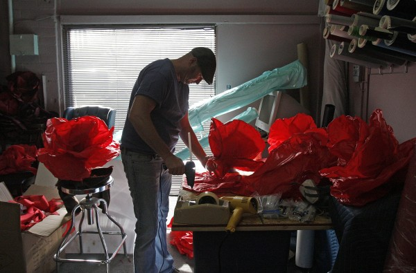 Sam Rhymes makes polyester (fabric) petals at Goodnight & Co. Set Builders, Jan. 21, 2014, in Sherman Oaks, Calif. The fabric petals will be used on drapes for this year Oscars.