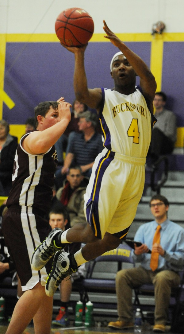 Bucksport's Josh Gray shoots over Washington Academy's Fred McLean on Friday night at Bucksport.