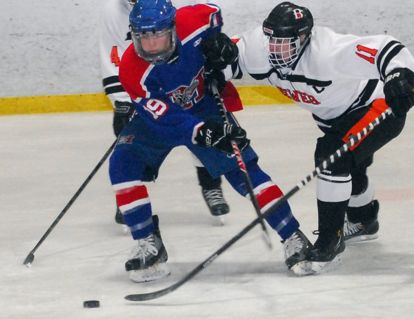 Messalonskee's Jared Cunningham (19) struggles against Brewer's Dylan Severance (11) in the first period of play at the Penobscot Ice Arena in Brewer on Wednesday.