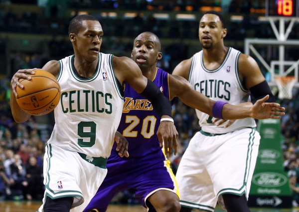 Boston Celtics point guard Rajon Rondo (9) works the ball against Los Angeles Lakers shooting guard Jodie Meeks (20) in the second half at TD Garden in Boston Friday night. The Lakers defeated the Celtics 107-104.
