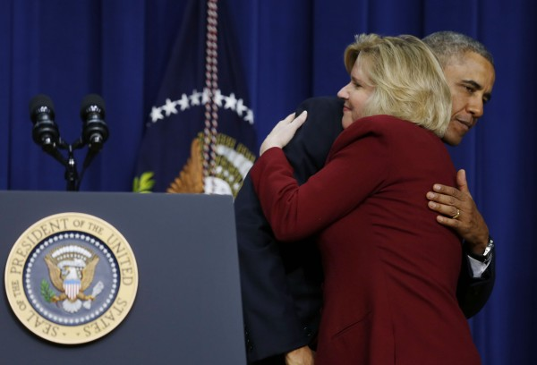 Jeanne A. Hulit is hugged by U.S. President Barack Obama after he announces his choice to replace her as the Administrator of the Small Business Administration while at a ceremony in the Eisenhower Executive Office Building on the White House complex in Washington, January 15, 2014.