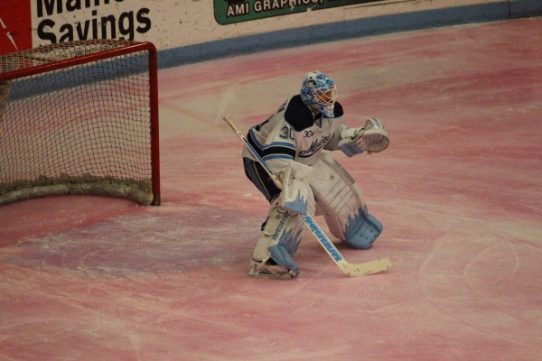 Maine goalie Dan Sullivan watches the action against St. Francis Xavier Tuesday night at Alfond Arena in Orono. Maine won the game 4-1 during the exhibition game, which was played on pink ice as part of Hockey East's Staking Strives initiative for breast cancer awareness.