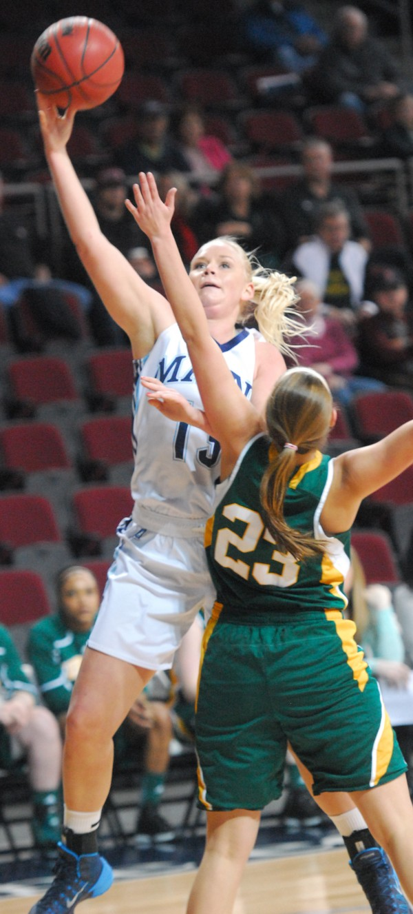 Maine's Mikaela Gustafsson puts up a shot over Vermont's Gracia Huston Tuesday night at the Cross Insurance Center in Bangor.