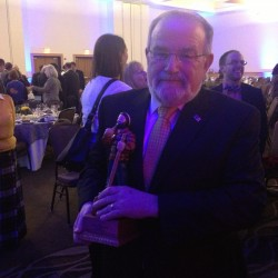 Miles Theeman, vice president and chief sales and marketing officer for Eastern Maine Healthcare Systems, received the Norbert X. Dowd Award at the Bangor Region Chamber of Commerce's 2014 annual awards dinner, held Wednesday at the Cross Insurance Center.