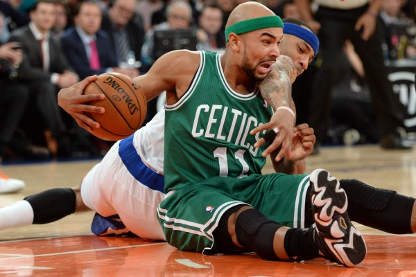 Boston's Jerryd Bayless (11) and Carmelo Anthony of the New York Knicks battle for a loose ball during the first half of Tuesday night's game at Madison Square Garden in New York.