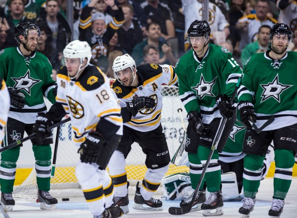 Boston Bruins center Patrice Bergeron (37) celebrates a goal against the Dallas Stars during the third period at the American Airlines Center Thursday night in Dallas. The Bruins defeated the Stars 4-2.