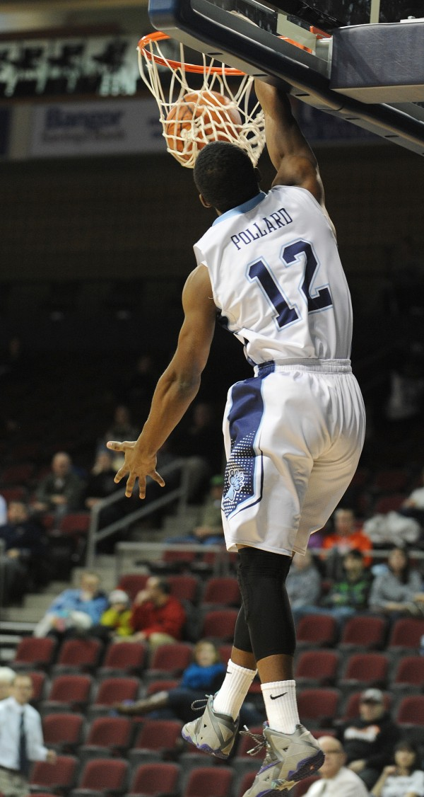 UMaine's Xavier Pollard slam dunks against UMass Lowell at the Cross Insurance Center on Thursday night.