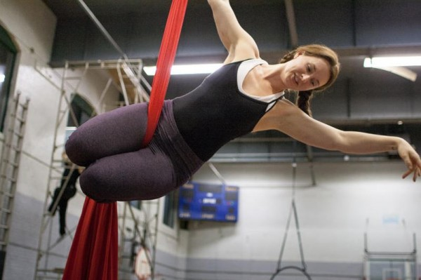 Sarah Huling, an instructor for Circus Atlantic, dangles from silks during a demonstration of aerial acrobatics at the Portland YMCA. Circus Atlantic is a youth program recently started by the Circus Conservatory of America, which plans to soon announce the date of its opening on Thompson's Point.