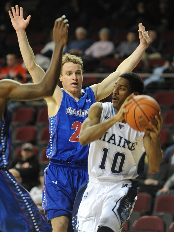 UMaine's Shaun Lawton looks for a shot while guarded by UMass Lowell's Tyler Livingston at the Cross Insurance Center on Thursday night.