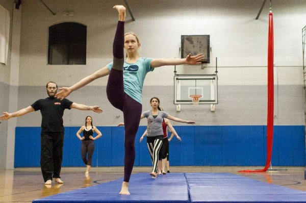 Sarah Norden, 14, of Yarmouth, stretches during a circus class at the Portland YMCA. Circus Atlantic, a youth program recently started by the Circus Conservatory of America, offers several weekly circus-arts classes in Portland and Freeport.