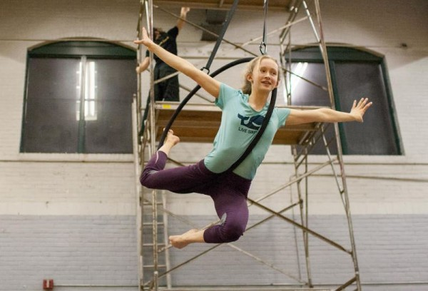 Sarah Norden, 14, of Yarmouth swings on a lyra during a circus class at the Portland YMCA.