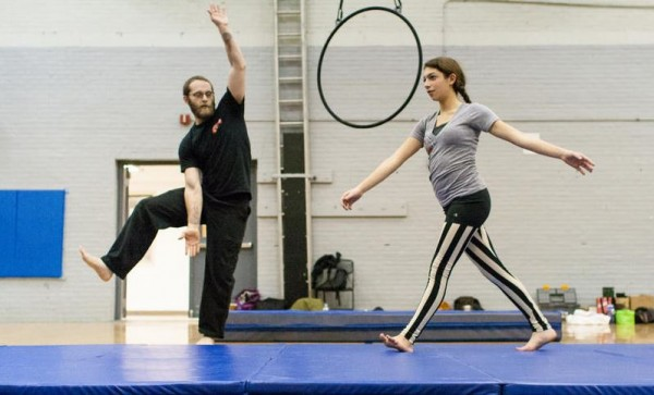 Kerry Kaye, left, an instructor at Circus Atlantic, trains JoJo Zeitlin, 15, of Cape Elizabeth in balancing techniques at the Portland YMCA.