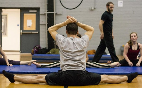 Blain Tully, an instructor for Circus Atlantic, leads students through a series of stretches at Portland's YMCA.