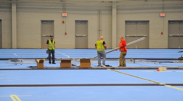 Crews work in the Field House at the University of Maine in Orono Wednesday. The first phase of the renovation of the Field House and Memorial Gym is nearly complete