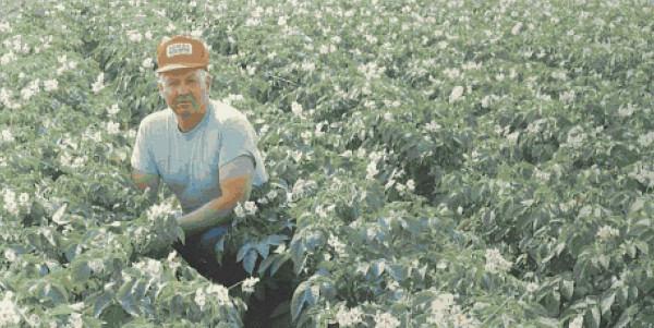 Rodney Sleeper, Vaughn's father, sits in a field on the Sleeper Farm.