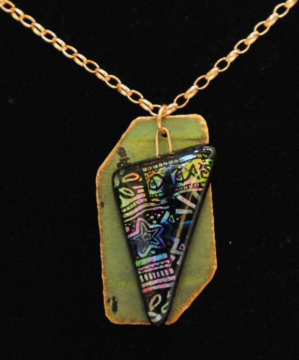 A copper necklace adorned with dichroic glass made from the old Bangor Public Library roof is just one of many pieces of jewelry up for bid at a silent auction at the library on Tuesday night.
