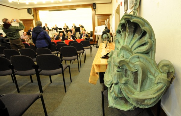 Copper ornaments from the old Bangor Public Library roof await bidding at a live auction at the library on Tuesday night.