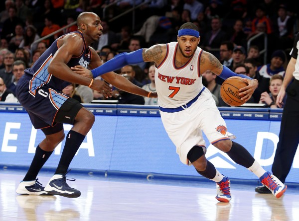 New York Knicks small forward Carmelo Anthony (7) drives to the basket against Charlotte Bobcats power forward Anthony Tolliver (43) in the second half at Madison Square Garden on Friday.