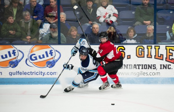 University of Maine's Devin Shore take control of the puck against University of New Brunswick's Cam Critchlow on Tuesday night at the Alfond Arena.