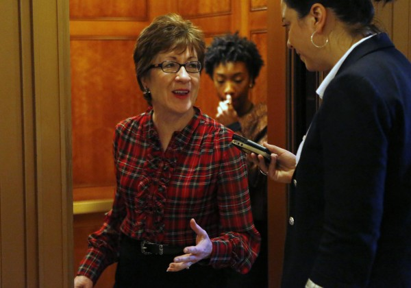 U.S. Sen. Susan Collins talks to reporters after a Senate cloture vote on budget bill on Capitol Hill in Washington Dec. 17, 2013.