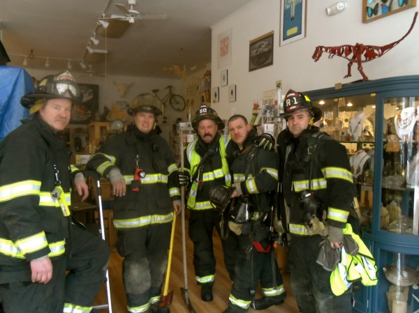 Bangor firefighters pose for a photo after shutting down a burst pipe on the second floor of 36 Central St. that was causing water to flow downstairs into the Rock & Art Shop.