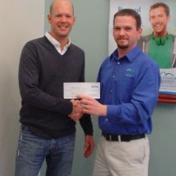 Trekkers' Executive Director Don Carpenter receives a donation from Bar Harbor Bank & Trust's Branch Relationship Manager, Greg Jones.