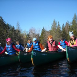 """Teen Trekkers and their mentors form a flotilla while canoeing at Acadia National Park."""
