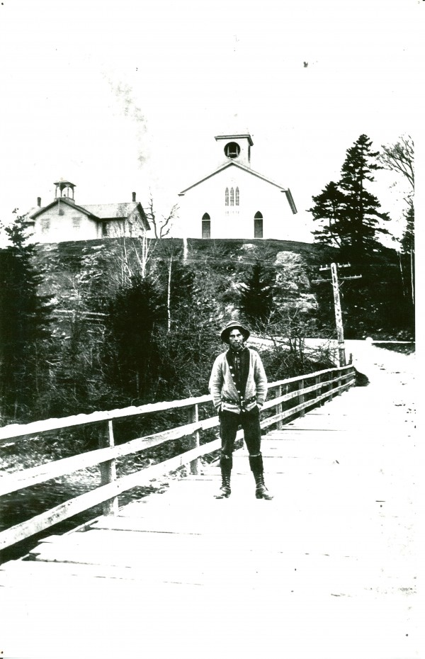 River Driver Ted Wilder on the Lower Bridge over the Dennys River in the spring of 1907.