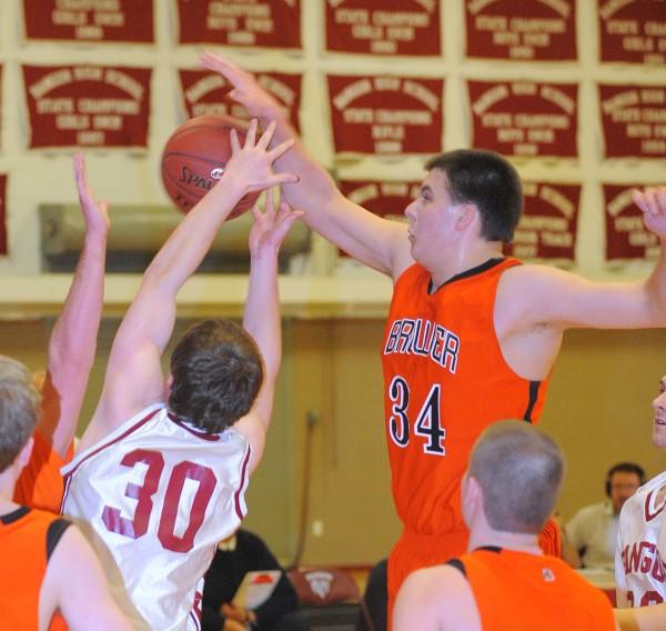 Brewer High School's Matt Pushard (right) and Bangor High School's Liam Harrigan battle for a rebound during the boys basketball game in Bangor Wednesday evening.