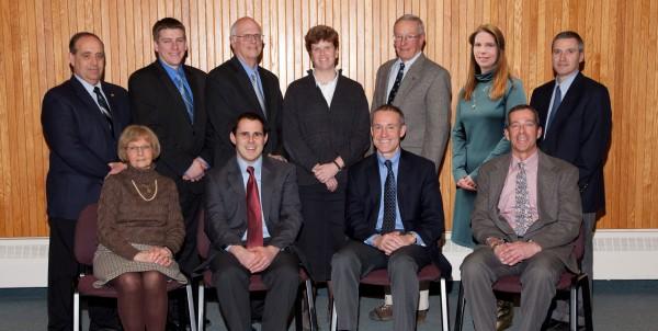 Cary Medical Center Board of Directors (Seated, L-R), Betty Hatch; David Sleeper, (Immediate Past Chairman); Gregg Collins, (Chairman); Rob Kieffer, (Vice Chairman);  (Standing, L-R), Jim Mockler; Austin Bleess; Peter Ashley; Sue White; Tom Goodyear; Sherri Dumont, D.O.; Carl Flynn, M.D.